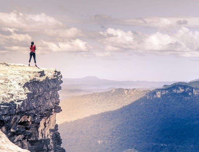Ochomiles, mujer en lo alto de un pico